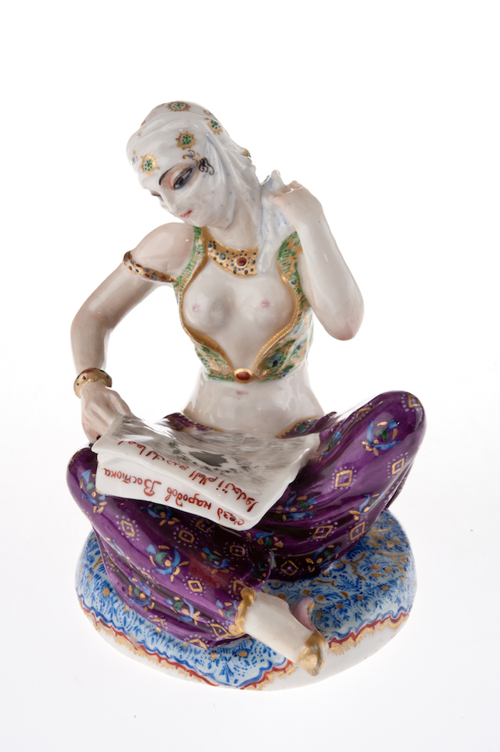 "Sculpture The Awakening East (Turkish Woman). State Porcelain Factory. 1921 model from 1922. Overglaze paintwork and gilding on porcelain. Height: 11.5 cm. Hand painted green overglaze mark: sickle and hammer. Hand painted artist's mark: ""1922 DE."""