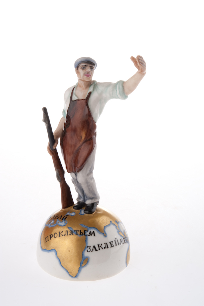 "Paperweight Call from the East (inscription in the half-sphere: ""Arise ye workers from your slumbers!""). Leningrad Lomonosov Porcelain Factory. Leningrad. 1920 model from 1922. Overglaze paintwork and gilding on porcelain. Height: 17.2 cm. Blue hand-painted overglaze mark: sickle, hammer, part of a gear, and year (1922). Hand-painted overglaze marks: ""1922"" and ""91/3."""